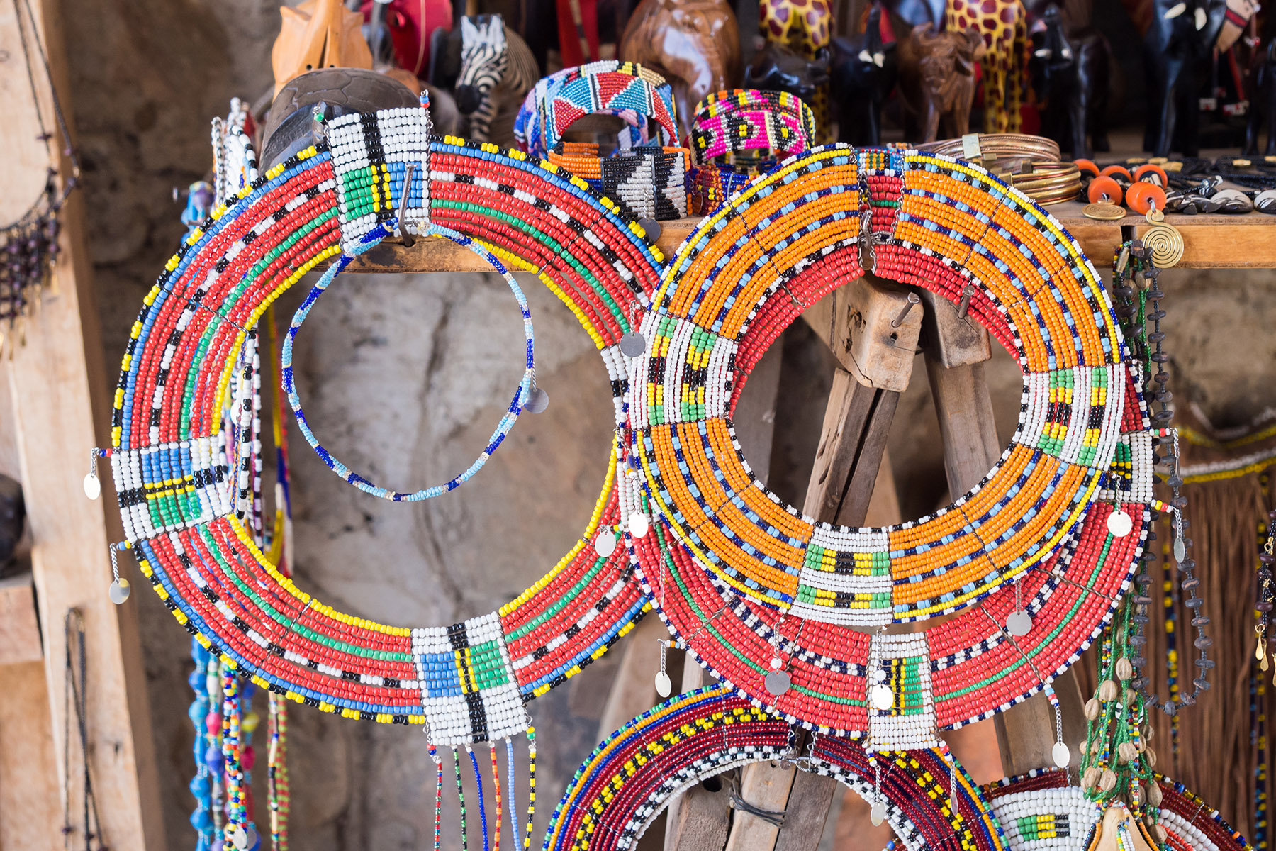 Colorful Maasai bead necklaces and other jewelry sold as a souvenirs at a local Maasai Market.